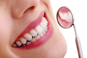 Healthy teeth in dental mirror