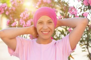 person undergoing chemotherapy happy and smililng