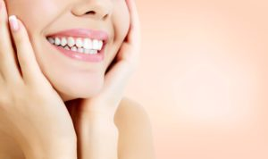 Woman with attractive smile using cosmetic dentistry in Dallas